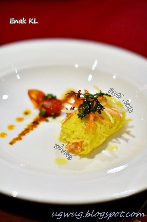 Roti Jala - Lacy pancake wrapped with prawn