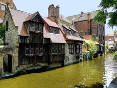 Bruges oldest timber house (jackfre2 (on a trip-voyage-reis-reise)) Tags: wood flowers windows house arch belgium timber bricks stainedglass led roofs tiles bruges portal woodenhouse chimneys flanders wow1 wow2 oldesthouse mygearandme mygearandmepremium ringexcellence