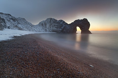 Pre Dawn Durdle Door (peterspencer49) Tags: winter mist snow seascape southwest clouds sunrise coast arch unitedkingdom unesco dorset stunning limestone coastline archway channel seaview seamist coastalpath westcountry seaarch southwestcoast durdledoor stonearch jurassiccoast winterview dorsetcoast southwestcoastalpath woldheritagesite stunningview seascene oceanveiw limestonearch cliffwalks 5dmkll peterspencer unitedkingdem stunningseascape