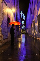 The Colours of Kimber Lane (missgeok) Tags: lighting colours kimberlane haymarket chinatown sydney australia reflections rain nightshot thecoloursofkimberlane laneway art artistic jasonwing inbetweentwoworlds blue orange dark night spiritfigures perspective path wetreflections orangeumbrella oneman purple wetsstreet lights streetscene lowlight atmosphere vi