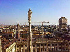 Milan, Italy panorama (elnina999) Tags: old city travel summer sky urban italy panorama sculpture milan detail building art rooftop church monument saint statue stone skyline sepia architecture clouds facade vintage town high italian worship europe downtown european catholic cityscape arch exterior view place cathedral roman sacral famous religion gothic style landmark center palace tourist panoramic aerial retro spire massive destination marble duomo ornate palazzo attraction realle