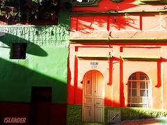 PROMISES OF SUNSET (emilioescalona) Tags: colombia bogot southamerica puertasyvenbtanas facades sunset atardeceres lightandshadows luz colorido