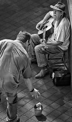 A Tip (Inge Vautrin Photography) Tags: streetphotography street city oklahomacity oklahoma ok okc usa urban people person performer streetperformer musician music guitar chair man men dollarbill money tip blackandwhite bw monochrome entertainer outdoors outdoor outside sitting walking