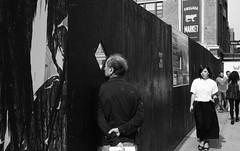 Man looking at construction site. New York City. September, 2016 L_M6_16783 (erlin1) Tags: 35mm 2016 analog bw blackandwhite film leicam6 newyork nyc september newyorknewyork nyny usausa m6v1 m6bw fav1 streetphotography
