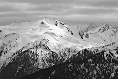 Stephen Peak, Hurricane Ridge (absencesix) Tags: adjectivesfeelingdescription assortedevents bw clouds contrasty emotion events evergreens hasmetastyletag heartothehillsroad hurricaneridge hurricaneridge05142011 locale locations mountains mountainsmountainranges naturallocale nature northamerica olympicpeninsula pinetrees plants portangeles serene sky snow soft stephenpeak theolympicrange trees unitedstates washington weather usa geo:lat=47967954 exif:model=canoneos7d camera:make=canon exif:iso_speed=100 geo:city=portangeles camera:model=canoneos7d exif:aperture=56 exif:lens=ef70200mmf28lisiiusm geo:lon=123501536 exif:focal_length=200mm geo:state=washington geo:countrys=usa exif:make=canon 11000secatf56 200mm ef70200mmf28lisiiusm canoneos7d iso100 noflash manualmode 2011 may may142011 selfrating4stars 4758463n12330553w portangeleswashingtonusa subjectdistance