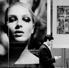 Contrast #5 (Explored) (. Jianwei .) Tags: street people blackandwhite bw beauty vancouver contrast poster focus candid pass makeup 85mm streetlife billboard 365 howe iphone 2011 a500 jianwei explored kemily streetphotographycandidstreetportrait