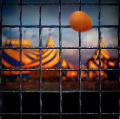 circus fence (marianna a.) Tags: blue sunset red sky orange canada yellow metal fence dark square de lumix grid evening soleil wire stuck quebec circus montreal painted balloon floating tent panasonic g1 hanging translucent transparent canadaday friday airborne caught cirque marianna cirquedesoleil hff armata mariannaarmata