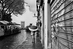A rainy day in Florence (guido.masi) Tags: rain umbrella florence rainy 400 plus firenze hp5 gt 35 pioggia ilford minox ombrello sspirito