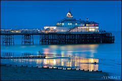 Eastbourne - Out for a Walk by Eastbourne Pier (Yen Baet) Tags: city uk greatbritain trip travel sunset sea vacation england reflection beach water architecture photography coast pier photo twilight europe european waterfront unitedkingdom britain dusk postcard scenic eu esplanade eastbourne coastline british bluehour seafront southcoast picturesque eastsussex eastbournepier britons pleasurepier yenbaet