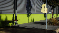 Taxi Stop (Theen ...) Tags: wood trees plants green metal wall bench shadows post taxi samsung stop tiles sit wait adelaide lime footpath polished yellowsign theen