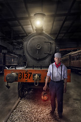The Graveyard Shift (aussiegall) Tags: lamp hat station yard scarf train tracks driver