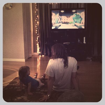 Cousin David and Ora watching Monsters inc.