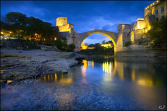 Blue hour over Stari Most (katepedley) Tags: world longexposure bridge blue heritage rock stone night canon river lights evening war europe mostar bosnia muslim tripod mosque unesco most hour herzegovina limestone 5d restoration balkans peninsula eastern 1740mm yugoslavia stari balkan polariser  slavic bosniaks