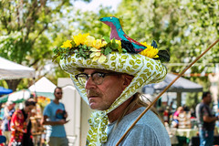 Bird In His Bonnet (Facundity) Tags: offcenterfolkartfestival albuquerque albuquirky newmexico robinsonpark costumeparade folkart canoneos70d naturallight whimsy streetphotography candid bonnet outdoors