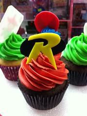 Superhero Cupcakes (Jenny Burgesse) Tags: robin cupcakes superhero fondant geeksweets comicbookshoppeartgala2010