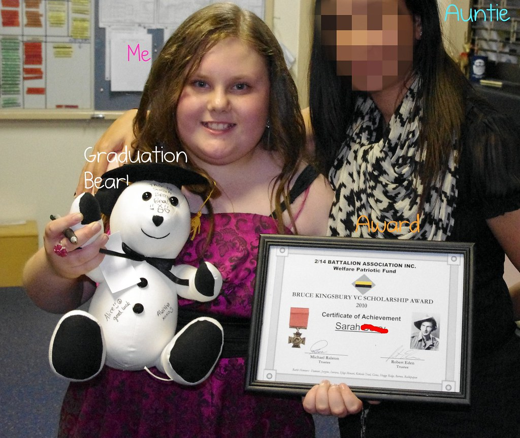 Grade 6 Graduation pic of me with my award, aunt and bear. :D