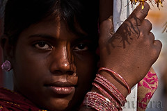 (Lopamudra9) Tags: world street light portrait orange india color art yellow festival children photography asia raw colours desert faces live indian low ngc nomad pushkar bazar aasia rajasthan earthasia