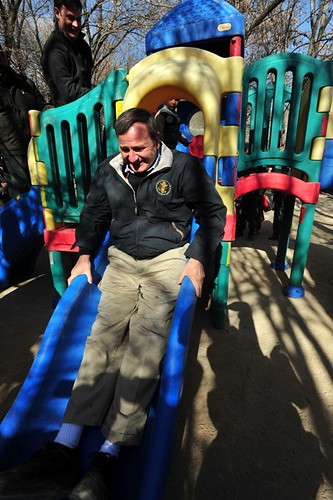 Karl Eikenberry, U.S. ambassador to Afghanistan, takes a test run on the slide during the playground dedication at Ghazni City Orphanage in Ghazni City on Dec. 15.