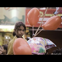 Mysterious Eyes......(Explored!!!) (H a s h e e d) Tags: girl eyes baloon streetphotography mysterious curious villagegirl nomadic rurallife