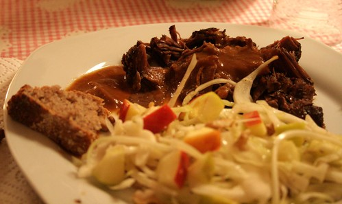 braised beef with rye bread and winter salad