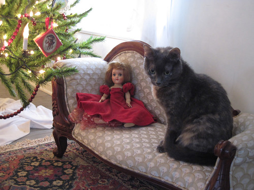 Penny and doll on settee