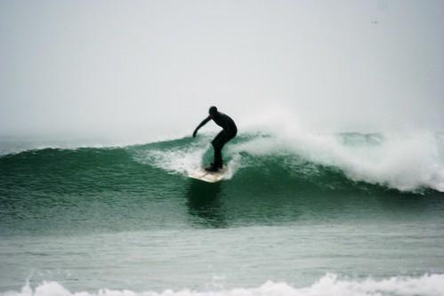 Riding the Surf at Newquay, Cornwall