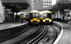 Two Trains (Olly Plumstead) Tags: bridge white black london lines station yellow trains leading selectivecolour twotrains commmute clickcamera ollyplumstead