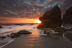 burning (Andy Kennelly) Tags: ocean california light sun hot beach wet water rock clouds long exposure waves pacific salt wave malibu southern burning cal shore heat flare jagged ripples burst