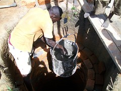 Lining the well with bricks