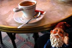 Klaus takes his coffee black (Caffeine Light) Tags: travel paris gnome amelie klausgartenzwerg cafedeuxmoulins theadventuresofklaus