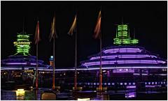 Neon Lights.. (Steve's Photography :-)) Tags: longexposure nightphotography paris france green ford night reflections nikon purple tripod flags disney neonlights d200 themepark carride wetfloor disneylandparis flagpoles autopia cs5 steveclancy