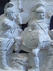 Fragments of the frieze from the Basilica Aemilia in  the Forum Romanum depicting two soldiers in crested helmets 1st century BCE-1st century CE (2) (mharrsch) Tags: italy sculpture rome soldier pegasus helmet frieze armor warrior shield armour forumromanum palazzomassimo 1stcenturybce 1stcenturyce basilicaaemilia mharrsch