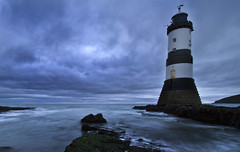 Something's brewing... (i.m.j.) Tags: sea lighthouse seascape seaweed water wales clouds dawn coast waves cymru wideangle stormy explore blackpoint anglesey canon1022mm ynysmn penmon arfordir tirlunlandscape explored trwyndu canon7d