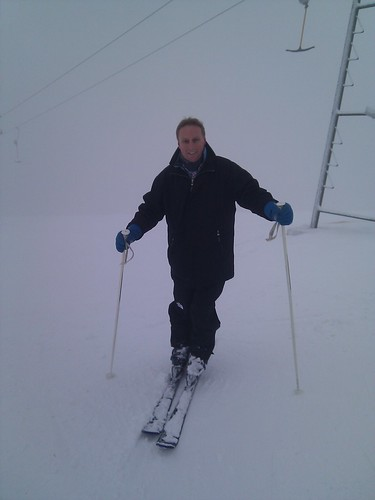 Skiing in the fog in Sauerland, the top of the mountain is in the clouds