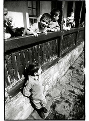 Creative Aid for Romania, Iasi, Romania - 04/92 (tobydeveson) Tags: portrait smiling 35mm blackwhite dragon vampire naturallight dracula communist communism porch devil fullframe transylvania gypsy uncropped kodaktmax400 gypsies draco rumania romanian drac orphanages havingfun roumanie nikomat nikkormat youngboys moldavia scannedprint roumania countdracula ceaucescu easterneuropean bramstoker vladtheimpaler rundownbuildings ottomanempire romnia rumanian darkroomprint wallachia vladdracul romn drakulya kazklvoyvoda elenapetrescu orderofthedragon sonofthedragon princeofwallachia vladepe vladiiitheimpaler drculea leaningonwall nicolaeceauescu impalerprince vladiii romanianorphans  postceaucescu primefixed24mmlens rumn eararumneasc voivodeofwallachia wladislausdragwlya drakwlya leantoverpatio
