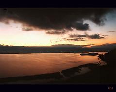 Ioannina and Pamvotis Lake, Epirus, Greece (George Megas) Tags: lake colour film nikon emotion dusk atmosphere greece negative fujicolor ioannina f55 pamvotis