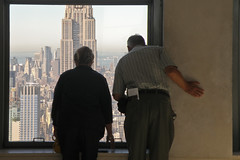 Hold on. (Mark Luethi) Tags: window couple looking tourists empirestatebuilding lookingdown oldercouple markluethi
