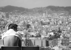 Watching over Barcelona (BenjaminJuell) Tags: barcelona city houses blackandwhite bw man mountains pool swimming canon is aperture dof bokeh depthoffield l 40 mm usm shutterspeed 24105