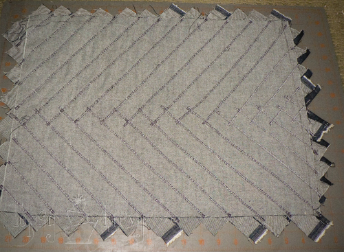 denim herringbone pillow underneath
