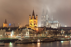 Kln Altstadt (Allard One) Tags: city longexposure nightphotography bridge panorama tourism misty fog skyline architecture night river germany deutschland nikon cityscape cathedral dom sightseeing january cologne panoramic le innercity brug riverbank rhine altstadt rhein koln nordrheinwestfalen stad rijn lightbeams architectuur januari newyearsday happynewyear duitsland kathedraal keulen rivier stmartinschurch northrhinewestphalia 2011 binnenstad jaarwisseling oever turnoftheyear nieuwjaarsdag rondvaartboten hohedomkirchestpeterundmaria waterflowing d700 rhineregion nikond700 nikkor2470mmf28 frankenwerft nikkor2470 nikon2470 nikonfx rhineships deutzerbrucke allardone allard1 noordrijnwestfalen allardschagercom