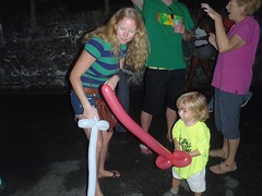Balloon sword fighting at Fish Friday - Gouyave