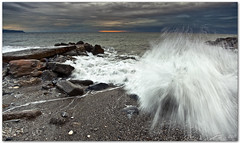 splash at dawn (chris frick) Tags: sea italy seascape motion sunrise dawn coast jetty liguria wideangle boulders filter lee splash mediterraneansea ballhead timing gitzotripod albenga chrisfrick canon1635mmf28liiusm 09nd canoneos5dmark2 075gndhard