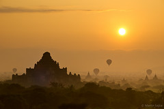 Sunrise over Bagan ~ Myanmar (Burma) (Martin Sojka .. www.VisualEscap.es) Tags: morning travel colors yellow sunrise landscape golden pagoda asia burma balloon vivid olympus myanmar zuiko bagan e5 1260 zd 1260mm