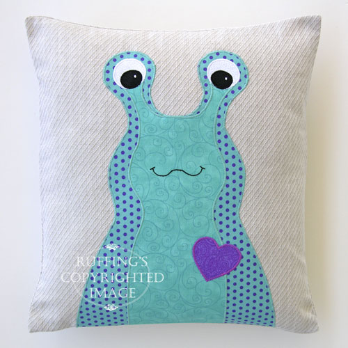 Turquoise, Purple, and Oatmeal Hug Me Slug Decorative Pillow by Elizabeth Ruffing