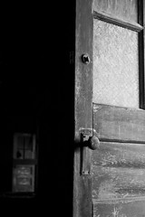 Aged (Universal Stopping Point) Tags: old school ohio abandoned dark doors decay naturallight hallway doorknob weathered dayton