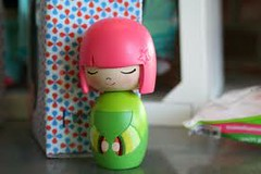 pink and green kokeshi doll