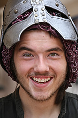 Helmet Up (wyojones) Tags: boy usa man guy net smile leather festival beard texas teeth paige greeneyes armor knight faire renaissancefestival merchant renaissance renfest salesman sherwood steelarmor wyojones sherwoodforestfaire helmelt
