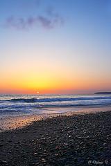 Memories of Summer (Didenze) Tags: california sunset sky sun seascape texture vertical golden rocks glow explore pacificocean orangecounty sanclemente goldenhour offcenter singlecloud lightreflections memoriesofsummer canonrebelxsi didenze