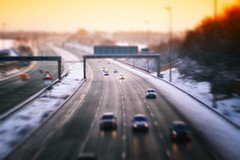 M6 Tilt (Sidaho) Tags: road uk travel winter light england snow motion blur cars film ice wet weather sign speed highway frost december driving traffic motorway britain great central grain bad shift autobahn headlights lancashire lane freeway preston tilt m6 bypass reservation lanes sleet wintery motoring fulwood j31 j31a