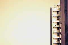 Suggest title? (Sonali Mangal) Tags: windows hot building yellow high apartments space dry sunny negativespace highrise column tall minimalism solitary minimalistic emptyspace
